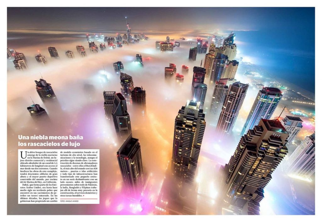 colors of dubai marina diffusing through thick fog covering the city